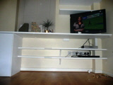 Home office desk with builtin shelving units